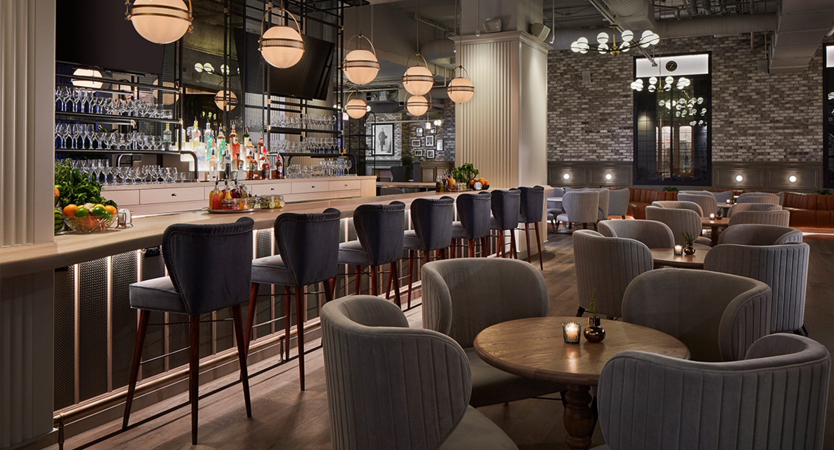 Visconti Mid-Century Modern Bar Chair in grey cotton velvet in a restaurant project