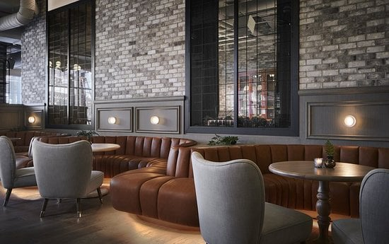 Zachary Hotel Restaurant with louis armchair and visconty bar chair by ottiuand